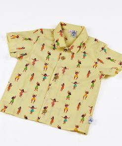 Camisa infantil Hula, camisa de niño, hecha en algodón orgánico, con estampado de chicas hula sobre fondo vainilla.
