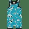 Mono estampado de algodón orgánico, de tirantes y pantalón corto, con bonito estampado de dinos sobre fondo azul y vivos a contraste en negro.