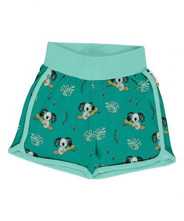 Pantalón corto, hecho en algodón orgánico, con divertido estampado de koalas sobre fondo azul y vivos a contraste en turquesa. Es una prenda unisex.