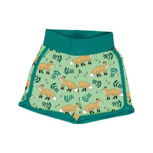 Pantalón corto, hecho en algodón orgánico, con divertido estampado de zorros sobre fondo verde y vivos a contraste en turquesa. Es una prenda unisex.